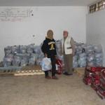 الجمعية الإسلامية توزع كفالات أيتام ومساعدات عينية ونقدية على الأسر الفقيرة